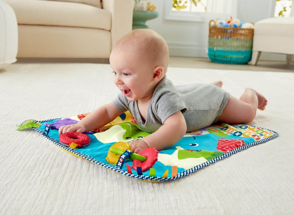 Baby crawling on a rug.