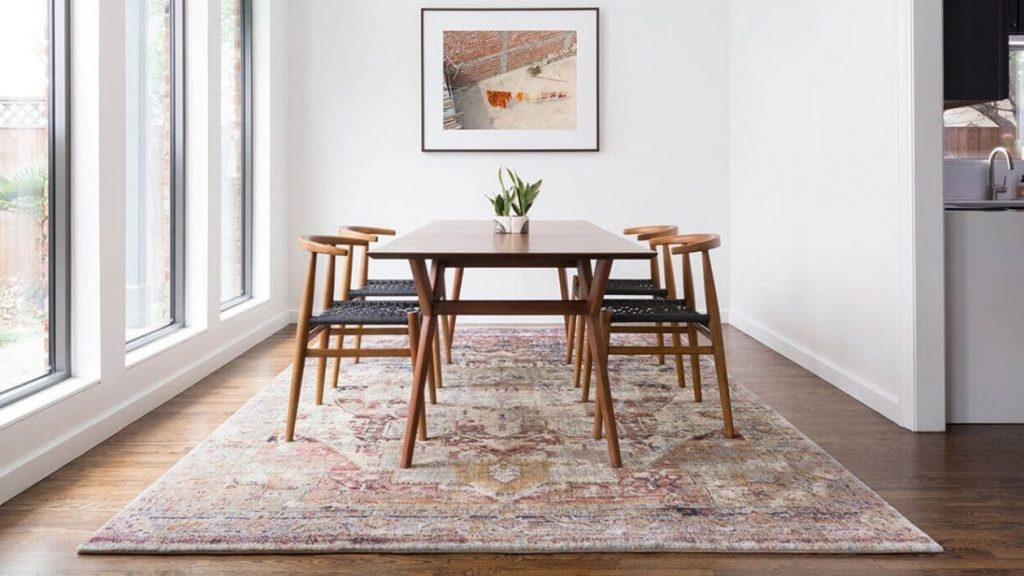You want to put a rug in places where furniture or high-traffic can damage hardwood floor.
